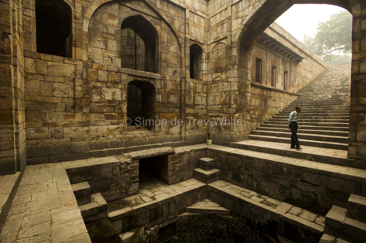 View of the well and steps leading up to the west at the Red Fort baoli