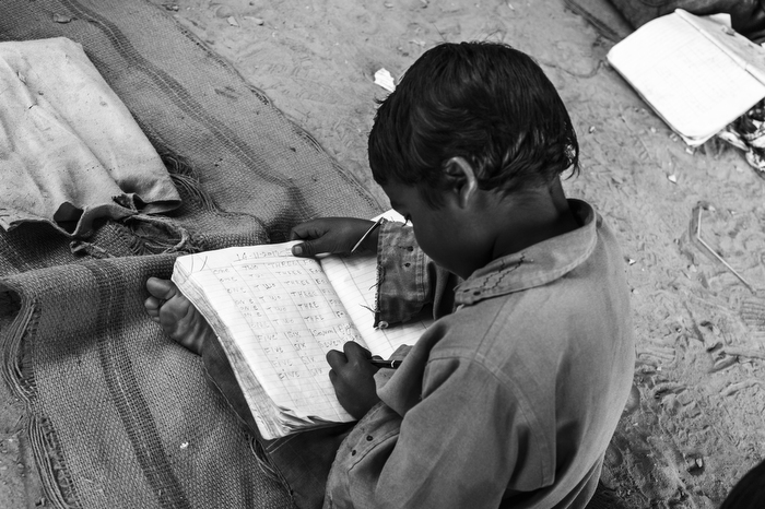 Dharam Pal (around 5 years old) studies