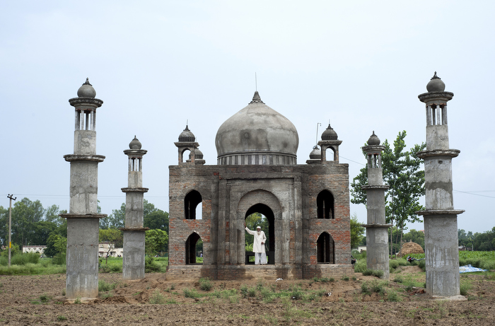 Mr Quadri stands in the doorway of his Taj-Mahal inspired mausoleum