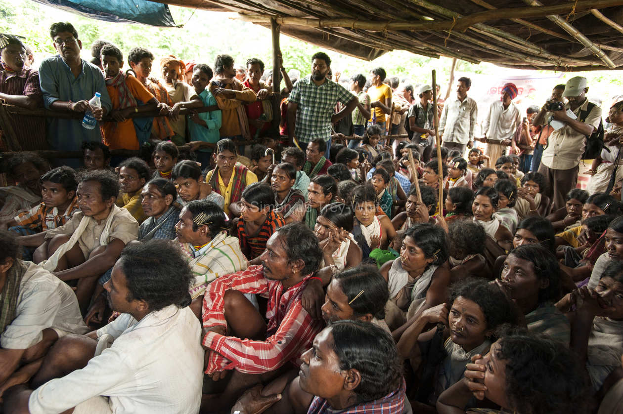 Dongria Kondha villagers observe and listen to proceedings from inside the Gram Sabha meeting hall