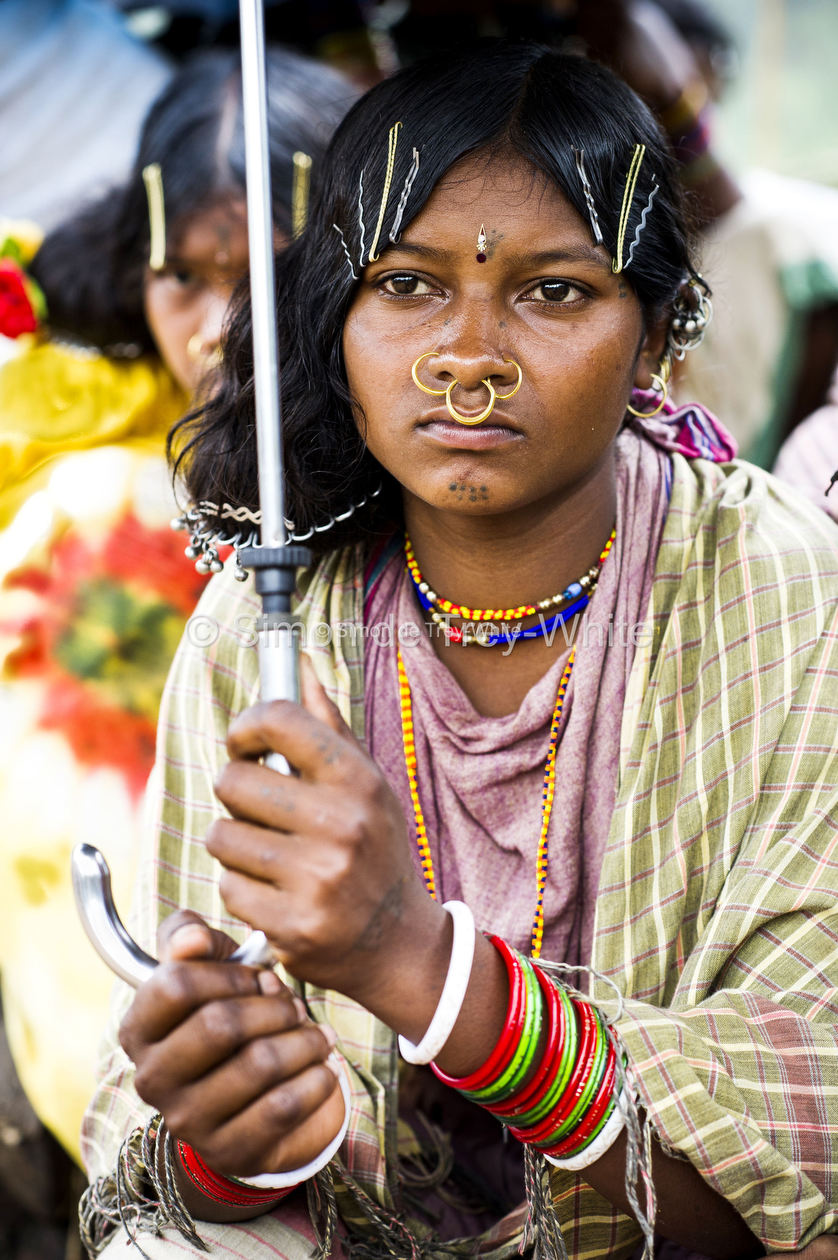 A girl of the Dongria Kondh tribe listens to proceedings from the Gram Sabha meeting hall in Lakhapadar village in the Niyamgiri Hills on the 7th August 2013