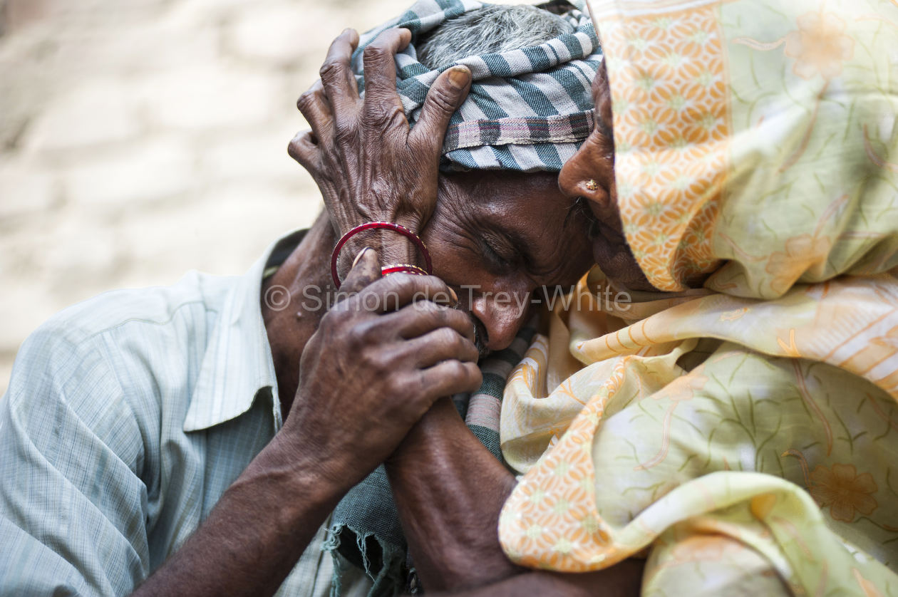 Sohan Lal (55) father of raped and murdered daughter teenager Murti (11 or 12) weeps and is comforted by his mother Ramkali