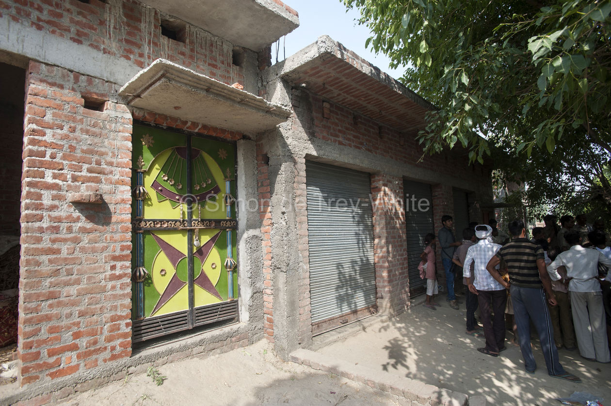 A view of the locked farmhouse of the three brothers (Avadesh, Urvesh and Pappu Yadav) accused in the rape and murder of two teenage girls in Katra Sadatganj village